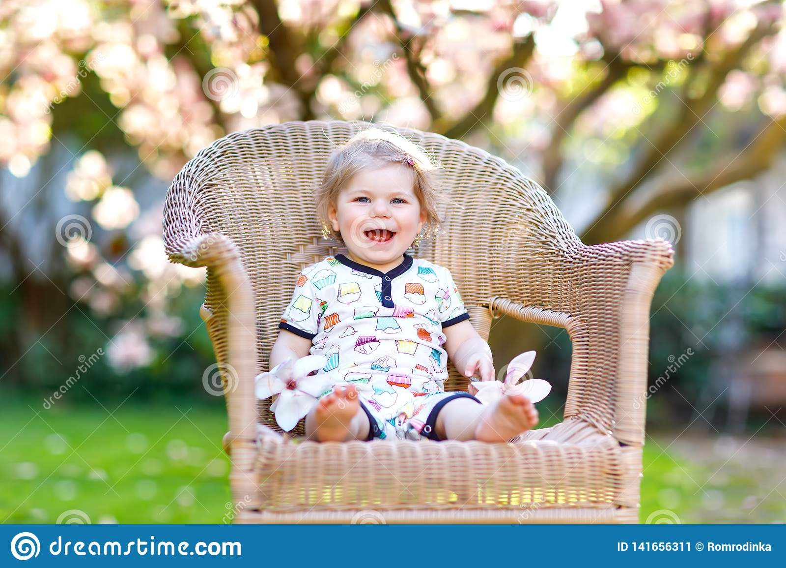 Cute Little Baby Girl Sitting On Big Chair In Garden Beautiful