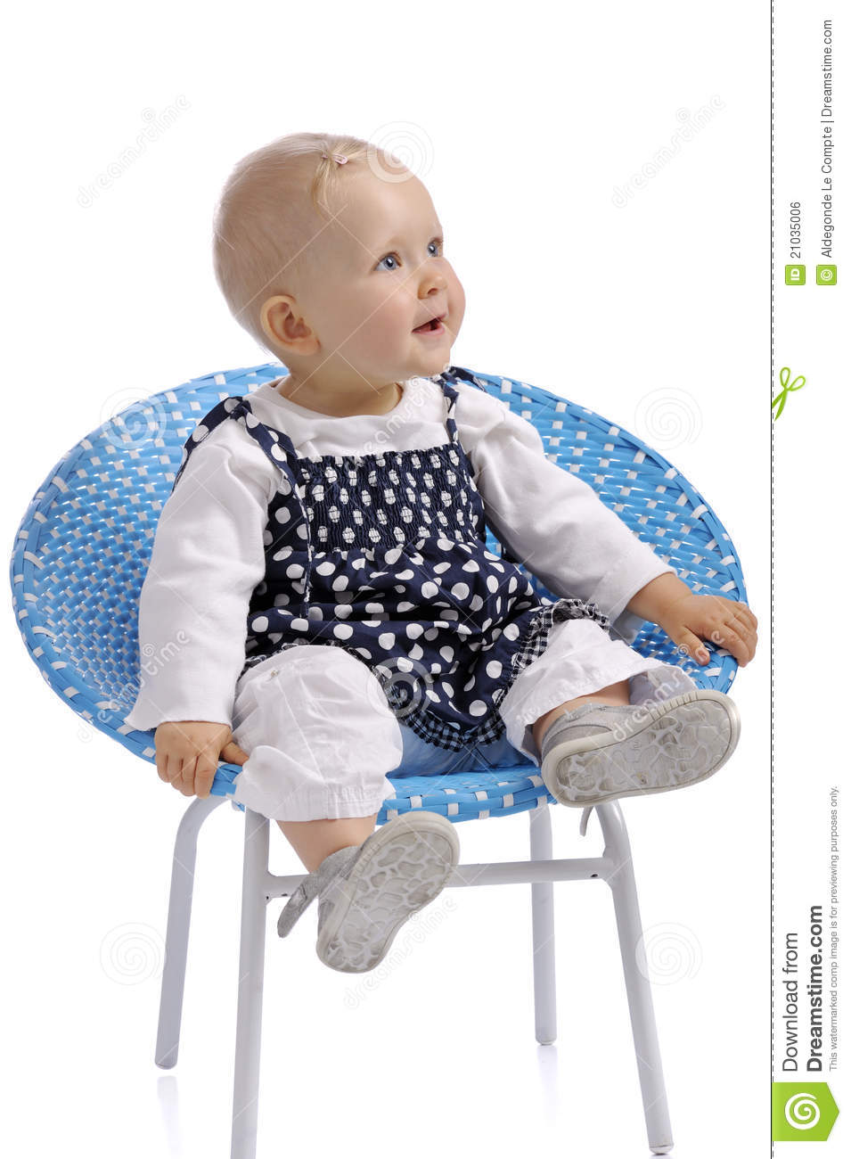 Cute little baby girl sitting in a chair stock photo for Toddler sitting chair