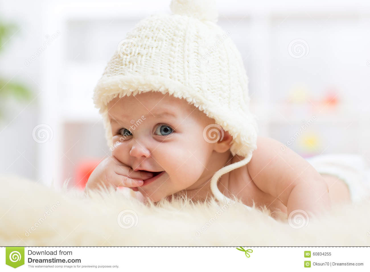 Cute Little Baby Looking Into The Camera And Stock Photo