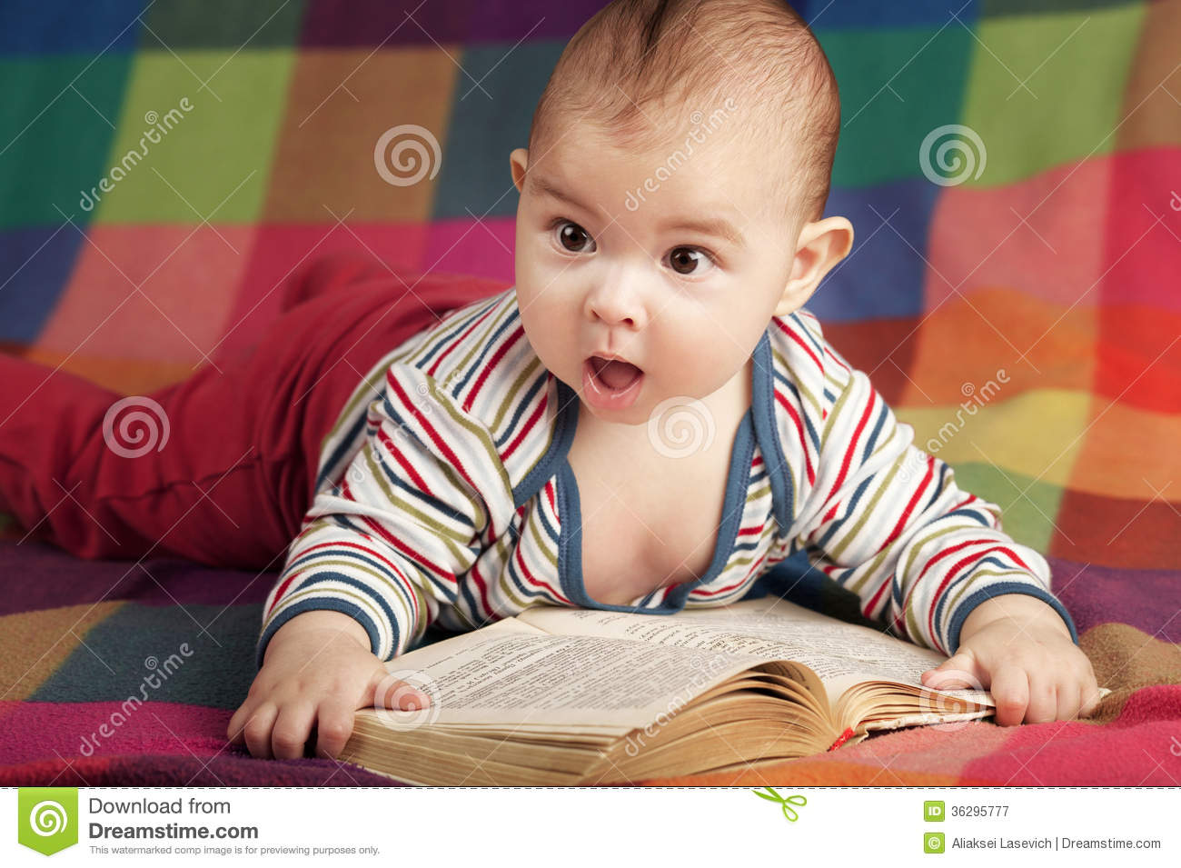 Cute little baby readi...