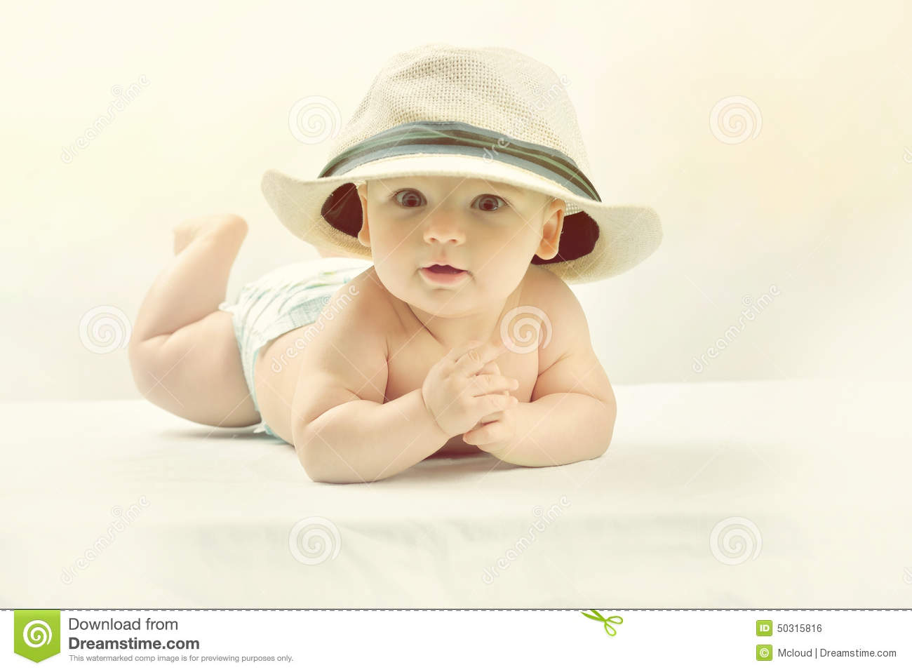 A Cute Little Baby In A White Hat. Stock Photo - Image of closeup ... d0a6545a48a