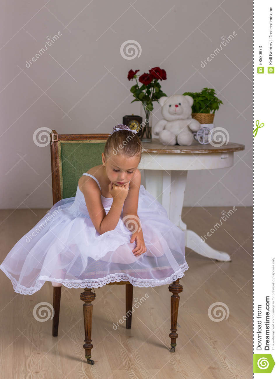 a3ccc1169 Cute Little Ballerina In A White Dress Sitting Stock Image - Image ...