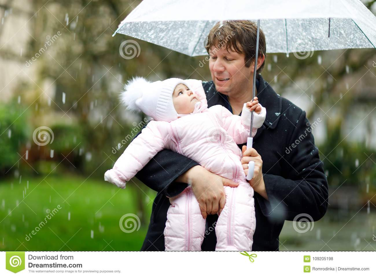 1b257d825f3e Cute Little Beautiful Baby Girl And Young Father On Cold Day With ...