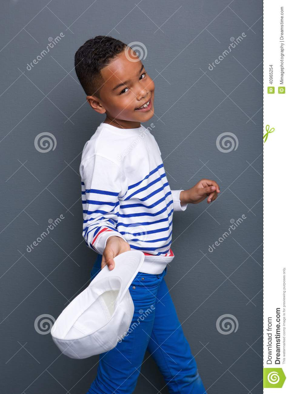 Cute Little Black Boy Smiling And Holding Hat Stock Photo 40965254 ... 7118c31413da