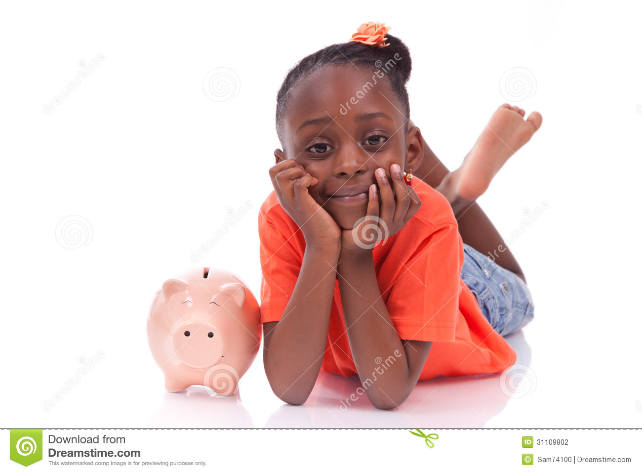 Cute little black girl with a smiling piggy bank isolated on white background african children
