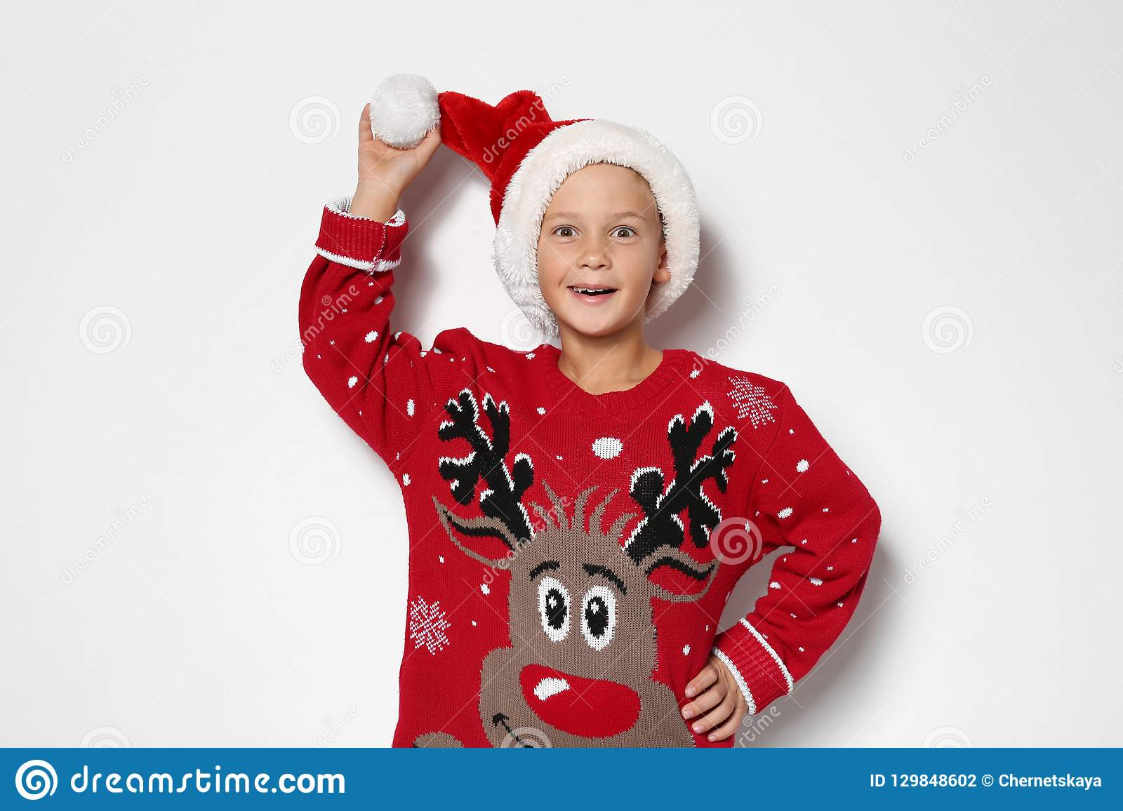 Cute Little Boy In Christmas Sweater And Hat Stock Photo Image Of