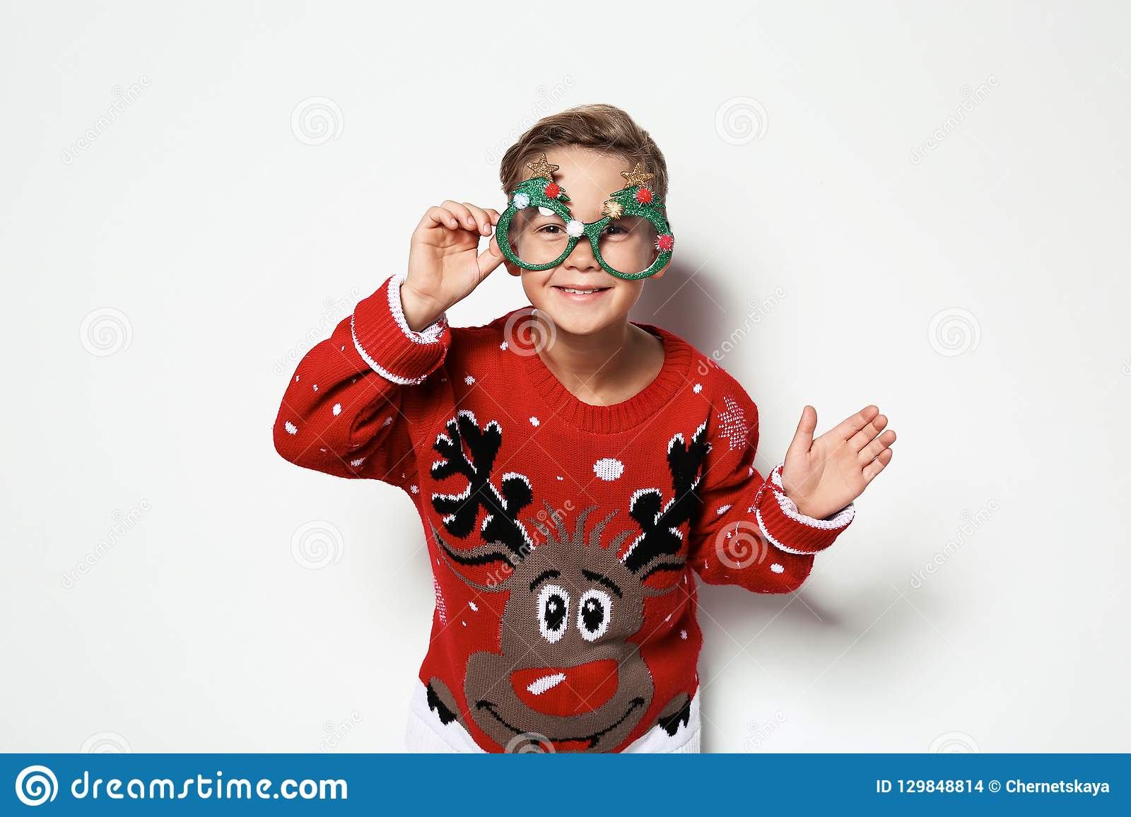 Cute Little Boy In Christmas Sweater With Party Glasses Stock Photo