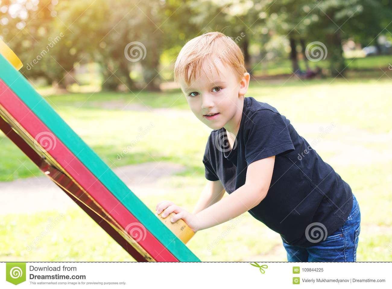 Cute Little Boy Climbing At Playground Outdoors Black Abd White