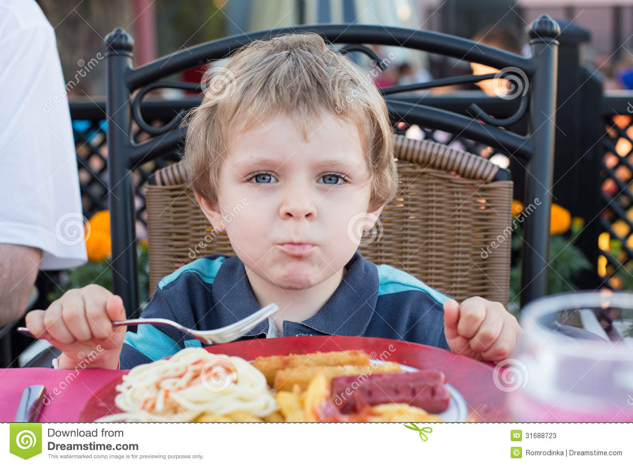 cfc86481c8c38 Cute Little Boy Eating French Fries In Summer Stock Image - Image of ...