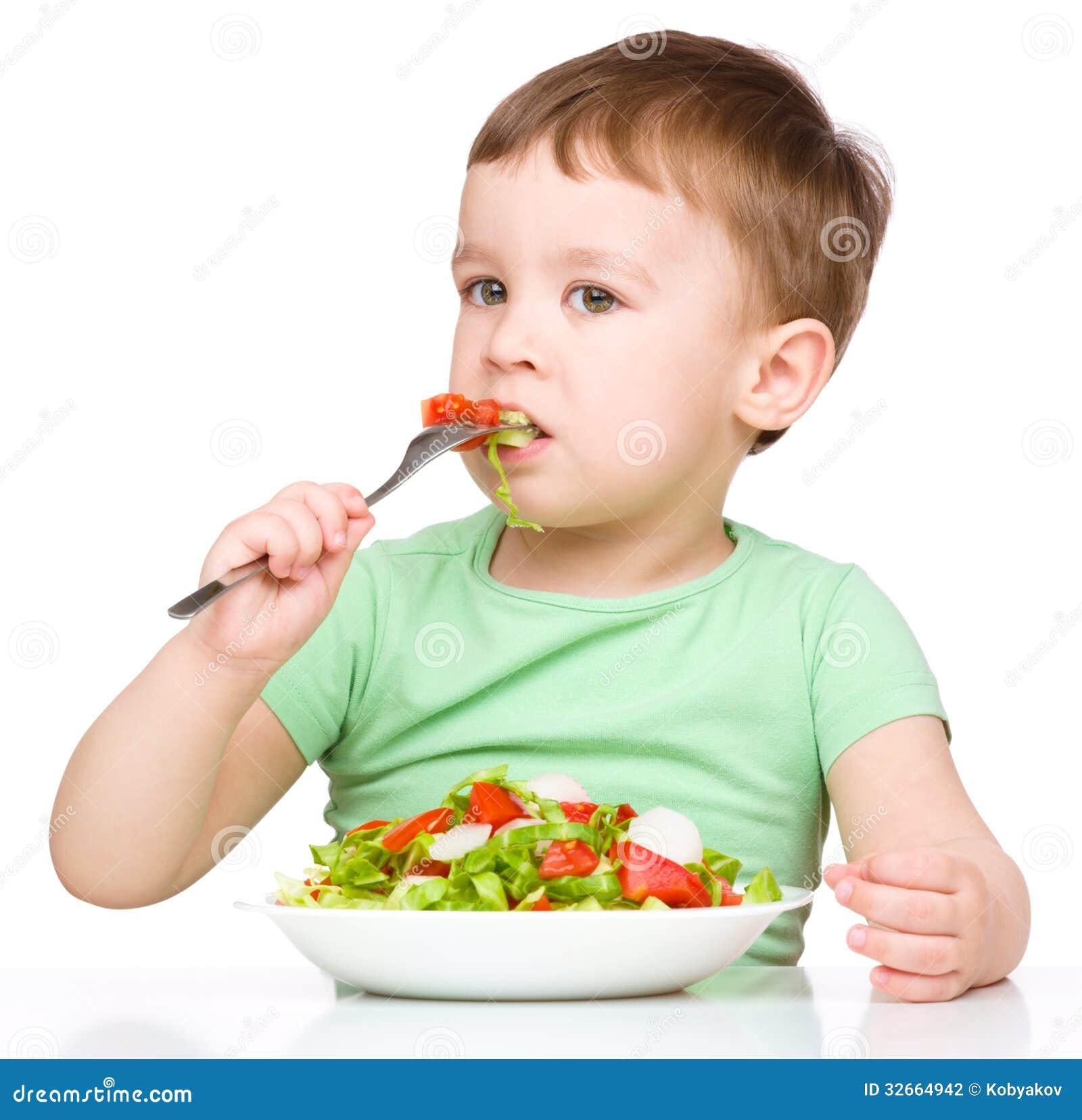 Little Kid Eating Vegetables