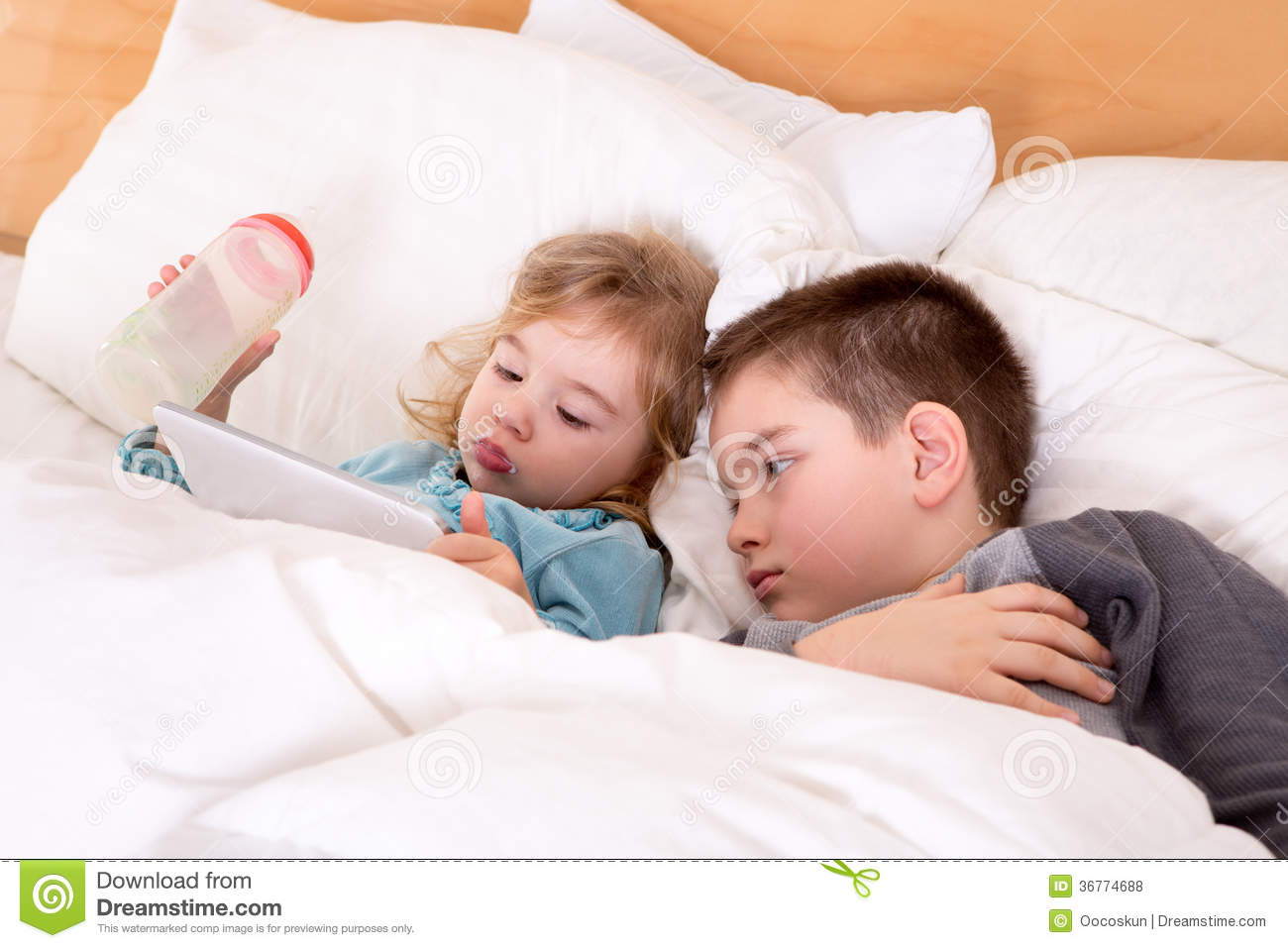 Cute little boy and girl reading before sleeping royalty for Bed stories online