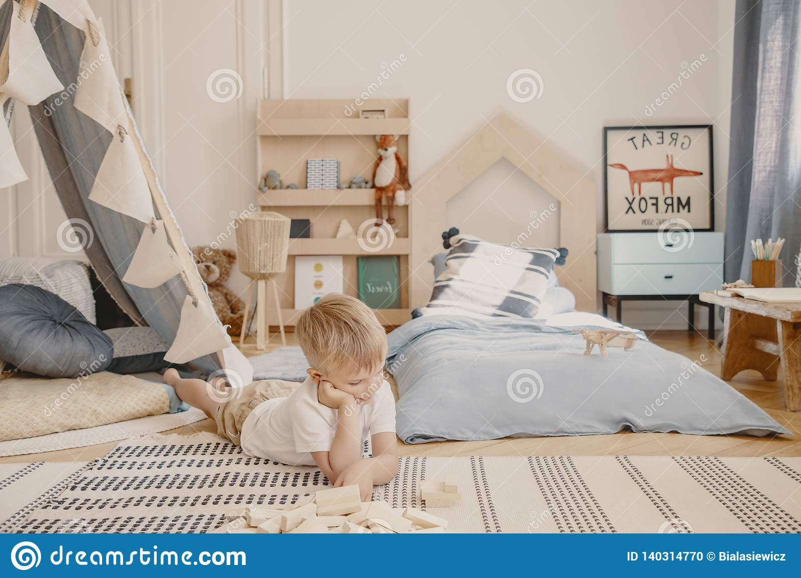 Cute Little Boy Laying On The Floor Of His Stylish Scandinavian Bedroom Real Photo Stock Photo Image Of Bedroom Cushions 140314770
