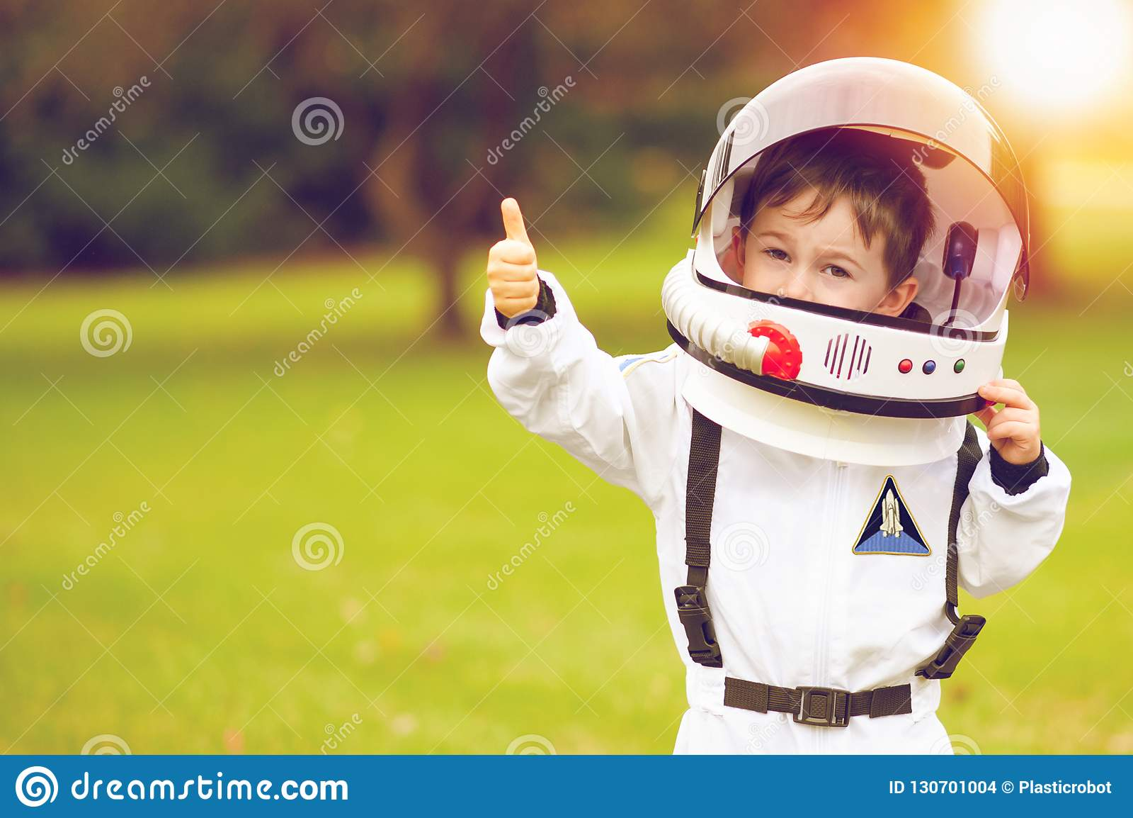 Cute little boy playing astronaut