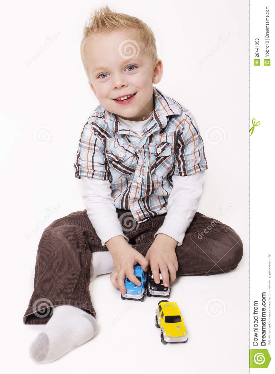 Little Boy Toys : Little boy playing with his car stock photo