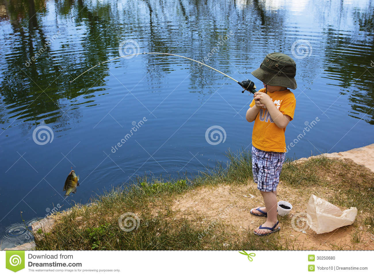 Little boy catching a fish stock photo image 30250680 for Little boy fishing