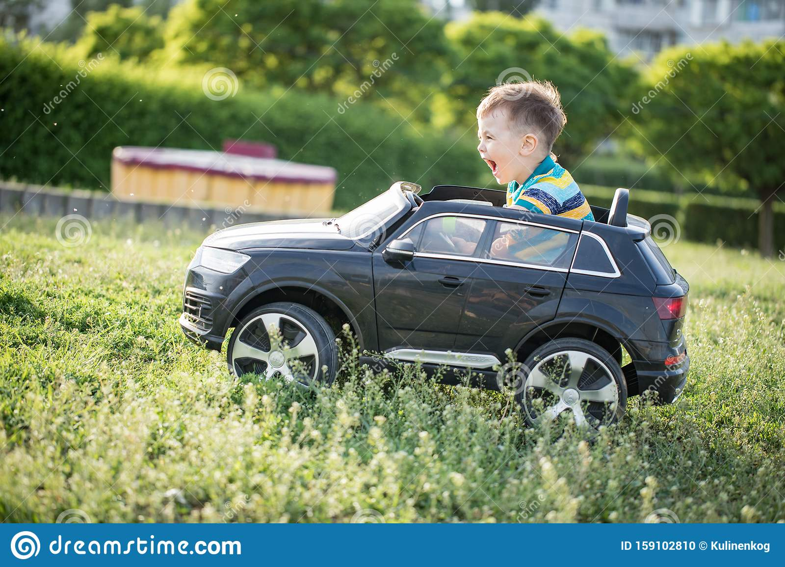Cute Little Boy In Riding A Black Electric Car In The Park Stock Photo Image Of Funny Activity 159102810