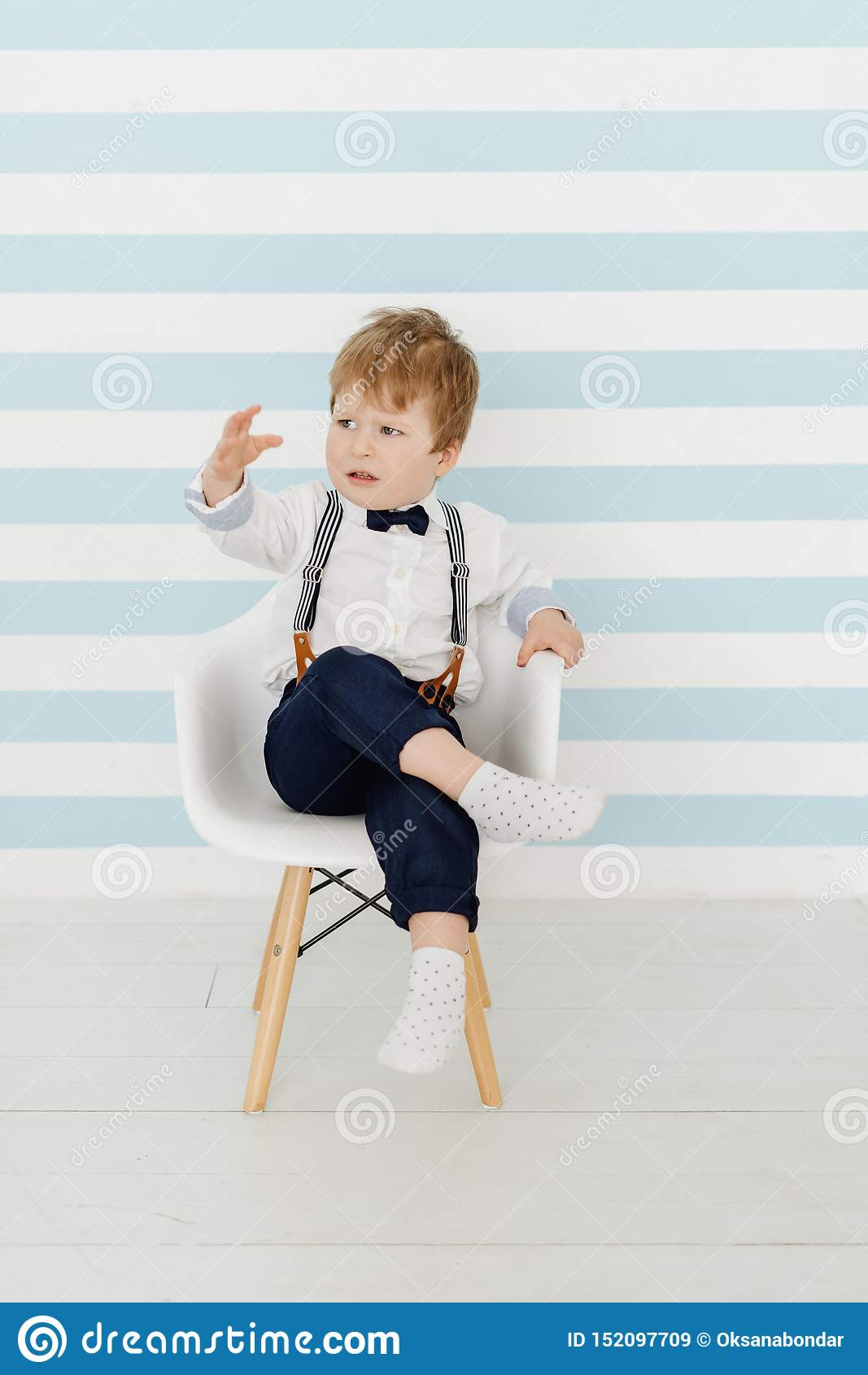 Little Boy Sitting On Potty Chair Stock Photo, Royalty
