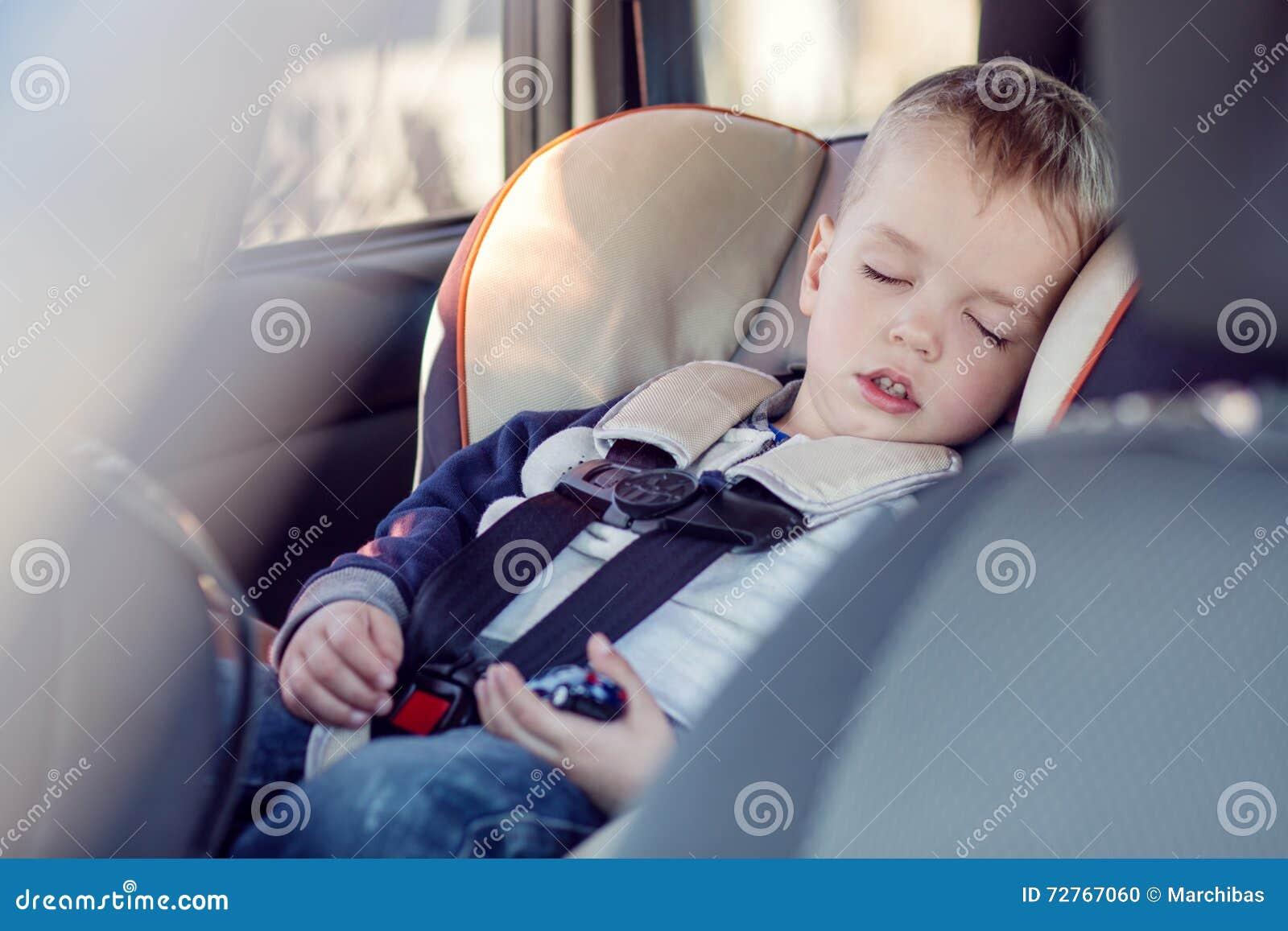 Cute Little Boy Sleeping In Car