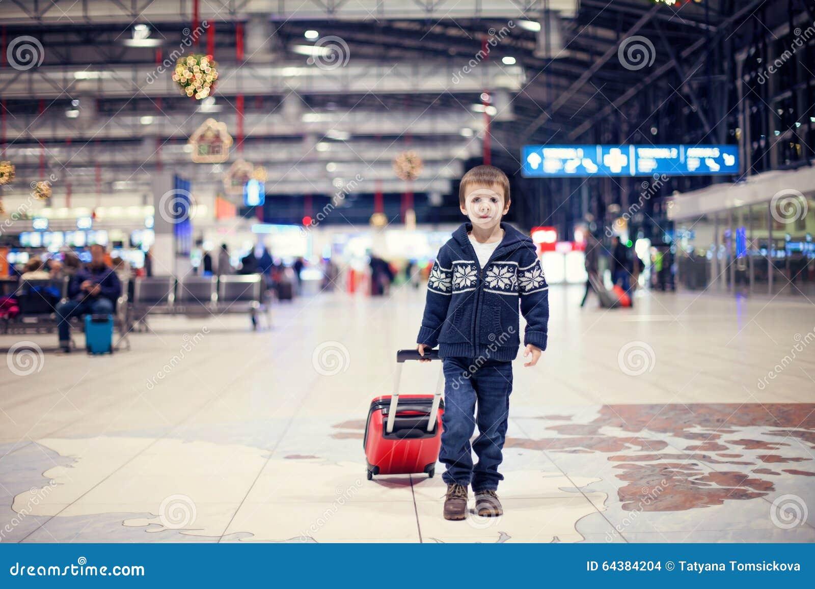 Cute Little Boy In Hat Lying On Traveling Map And Smiling ...  Little Boy Traveling