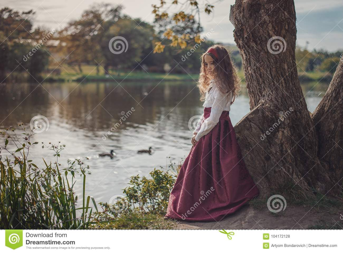 Cute little caucasian girl wearing retro clothes. Nice female child in beautiful vintage dress.