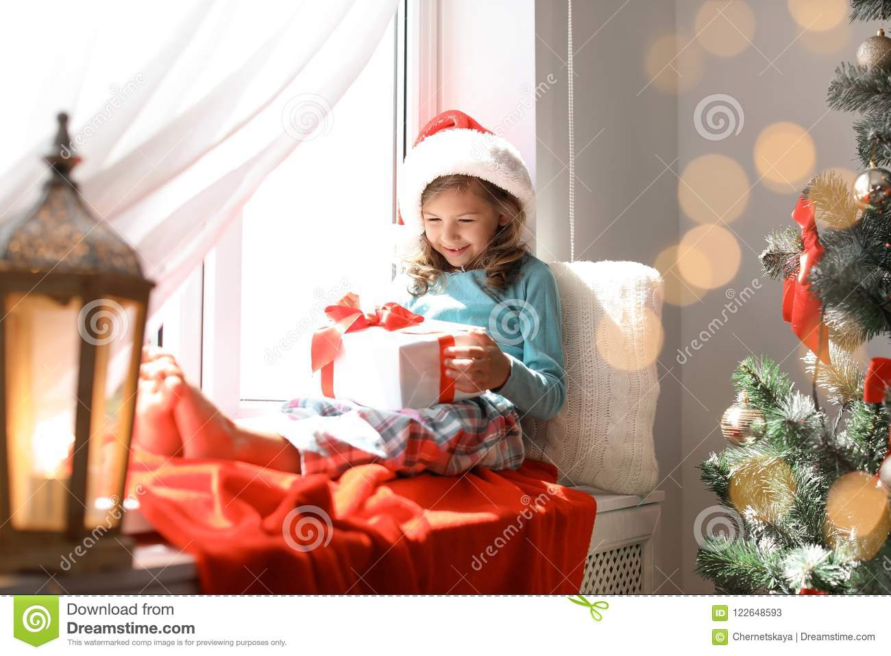 Cute Little Child In Santa Hat With Christmas Gift Box Stock Image ...