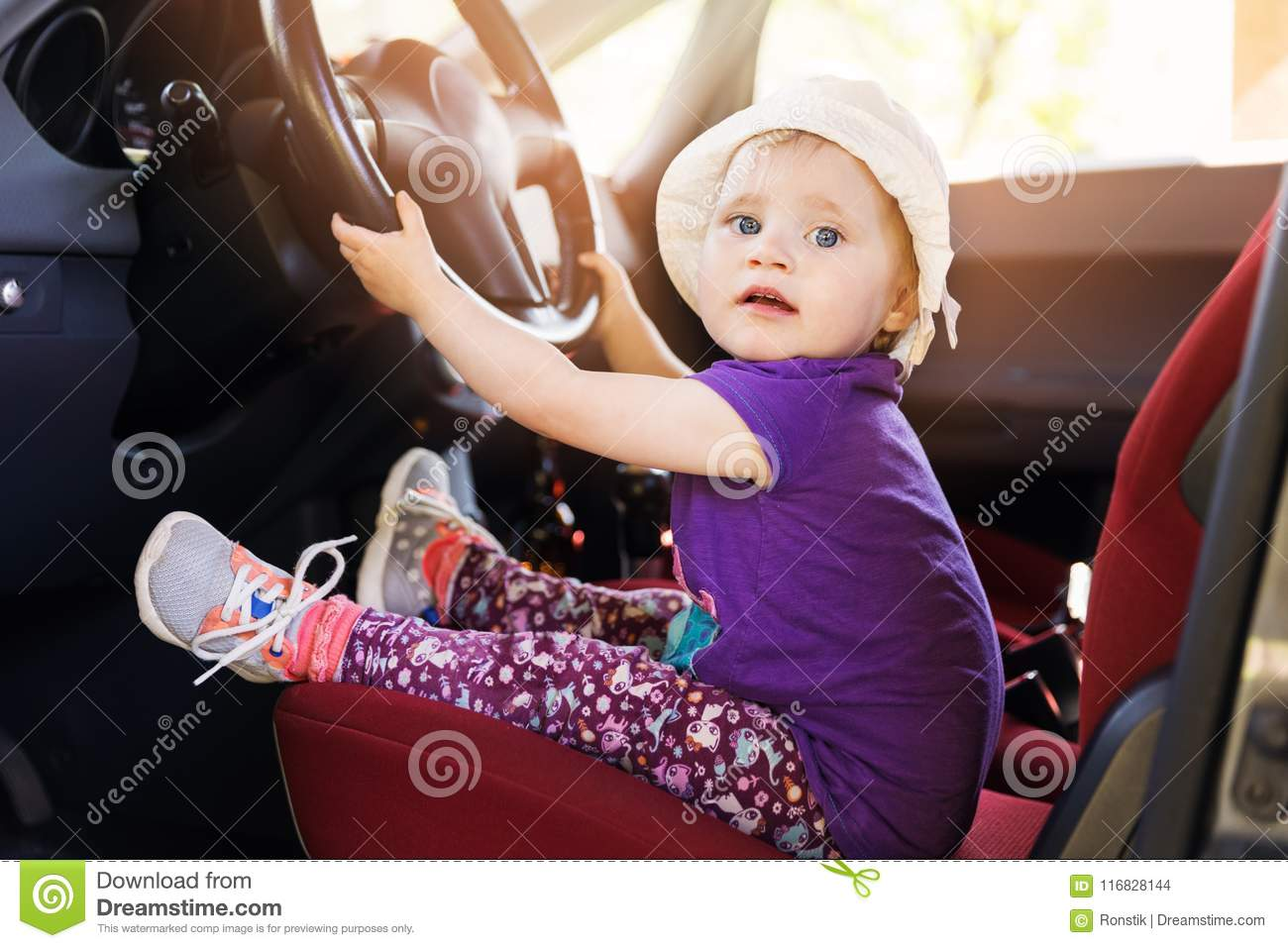 Child Steering Wheel In The Car