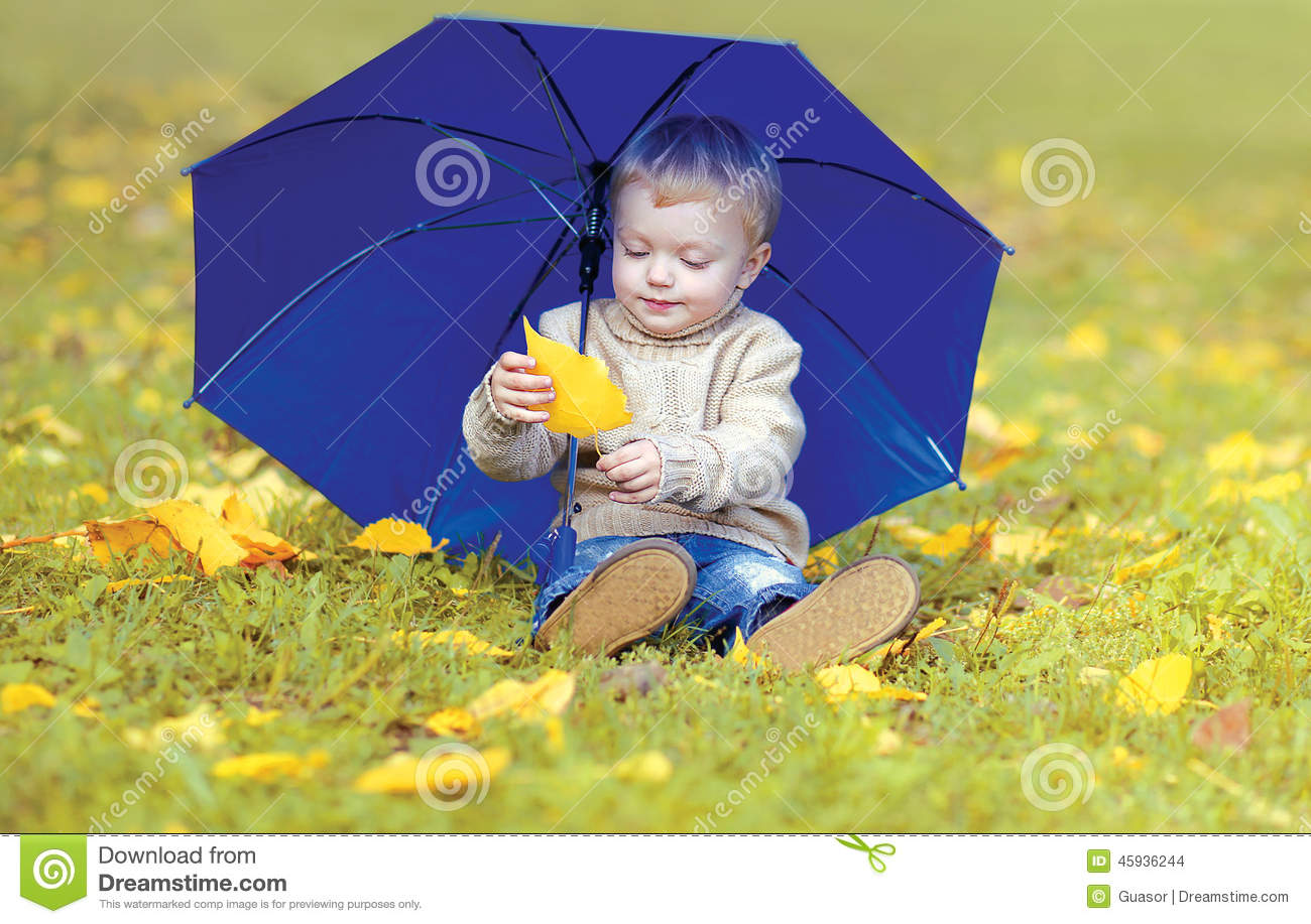 cute little child with umbrella in autumn stock photo image