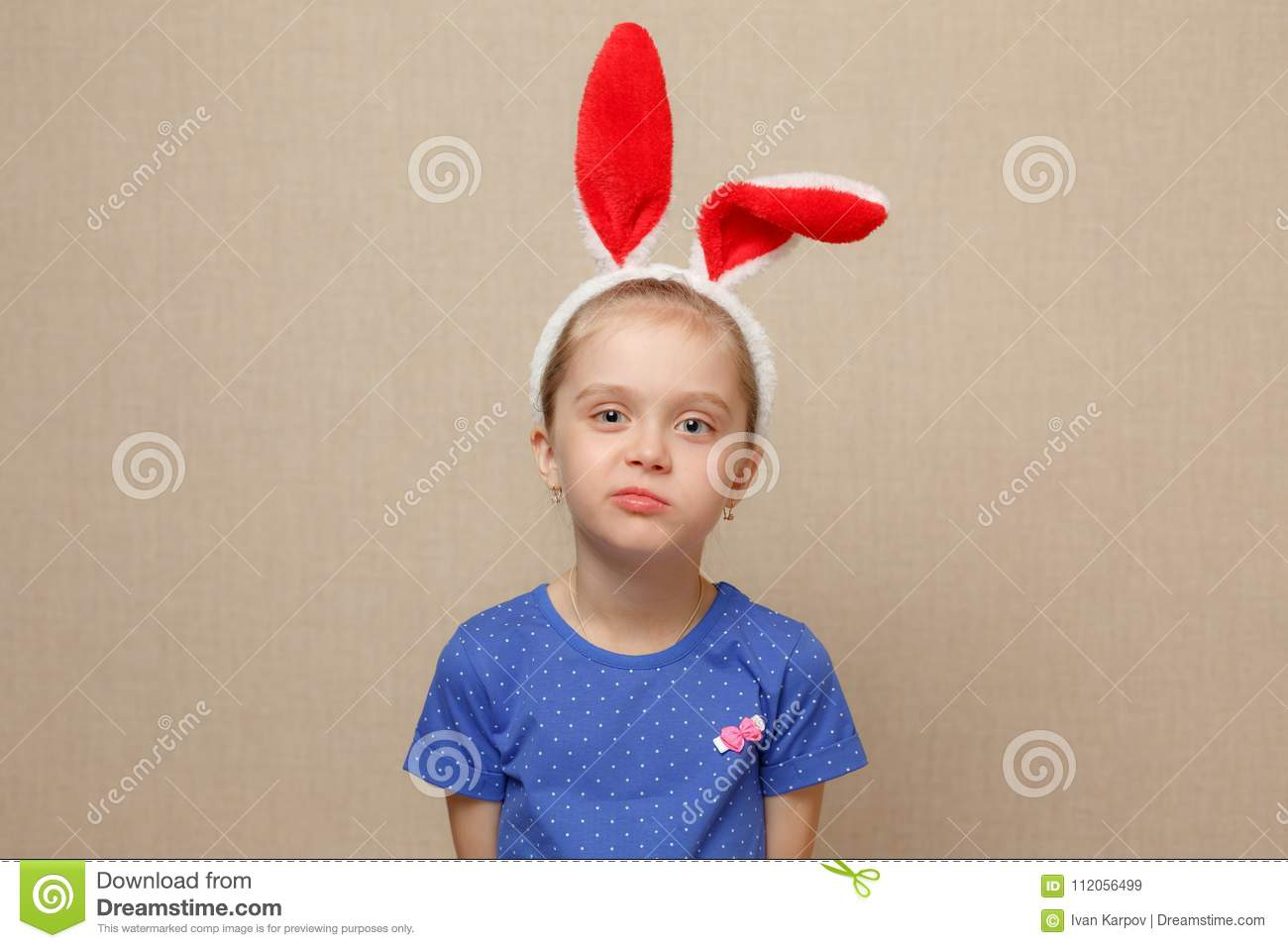 Happy easter. Child girl with bunny ears.