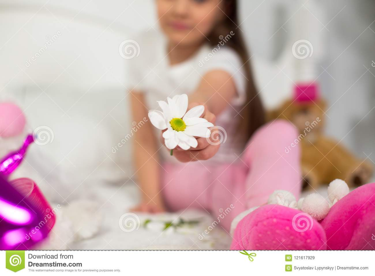 Young Girl Sitting On Her Bed With Flower Stock Image Image Of