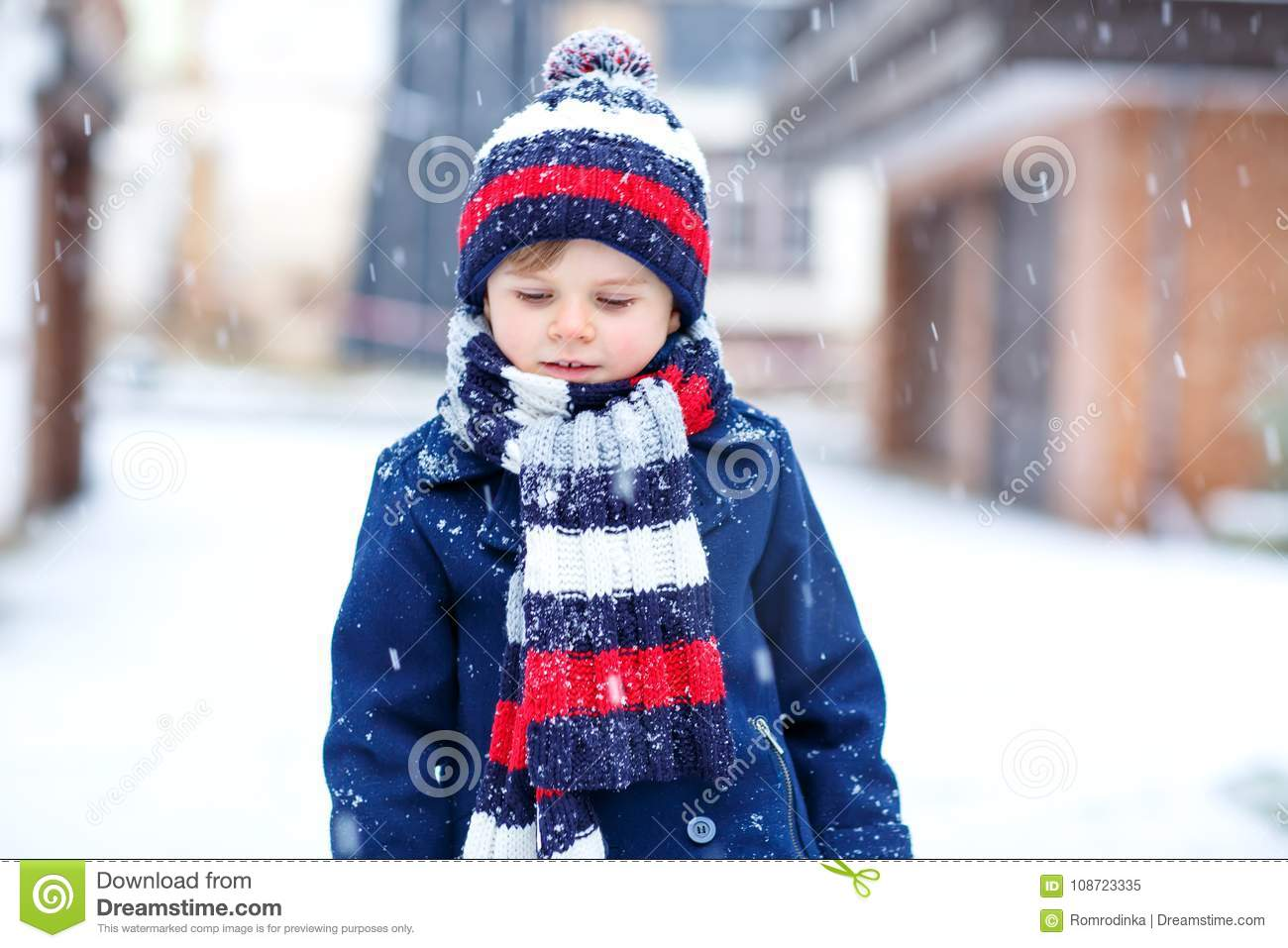 59d577da2 Cute Little Funny Kid Boy In Colorful Winter Fashion Clothes Having ...
