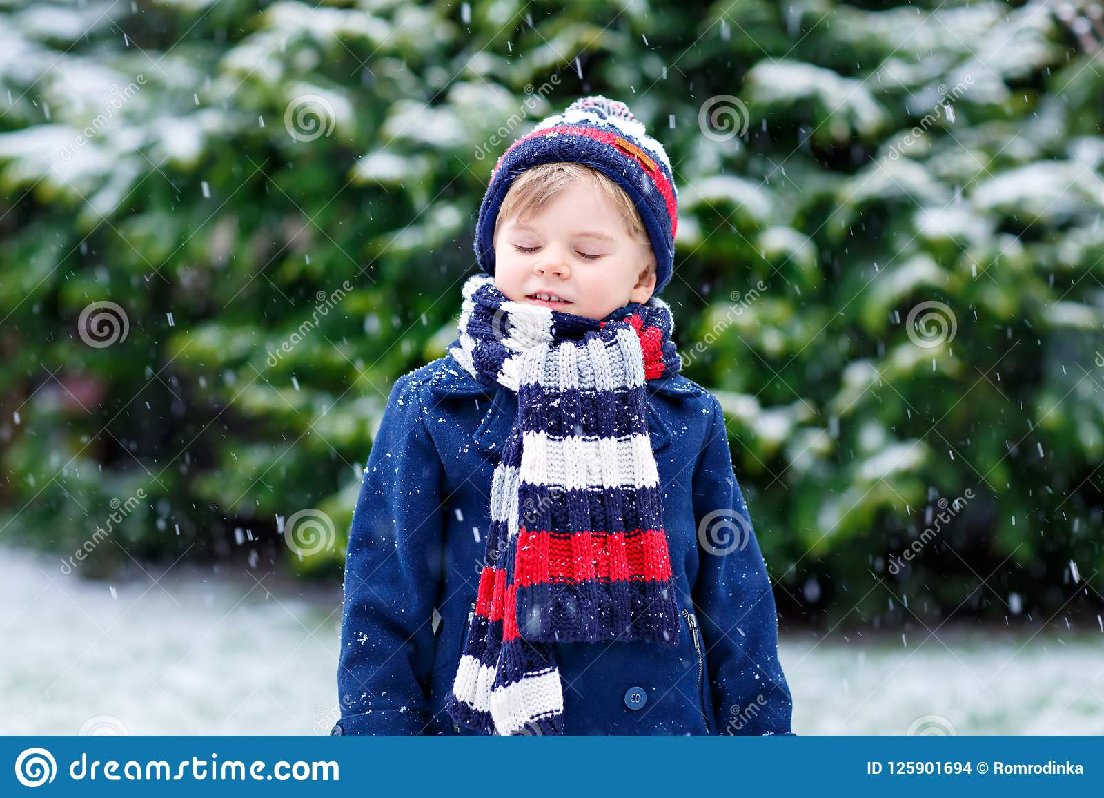 44b3904b5 Cute Little Funny Child In Colorful Winter Fashion Clothes Having ...