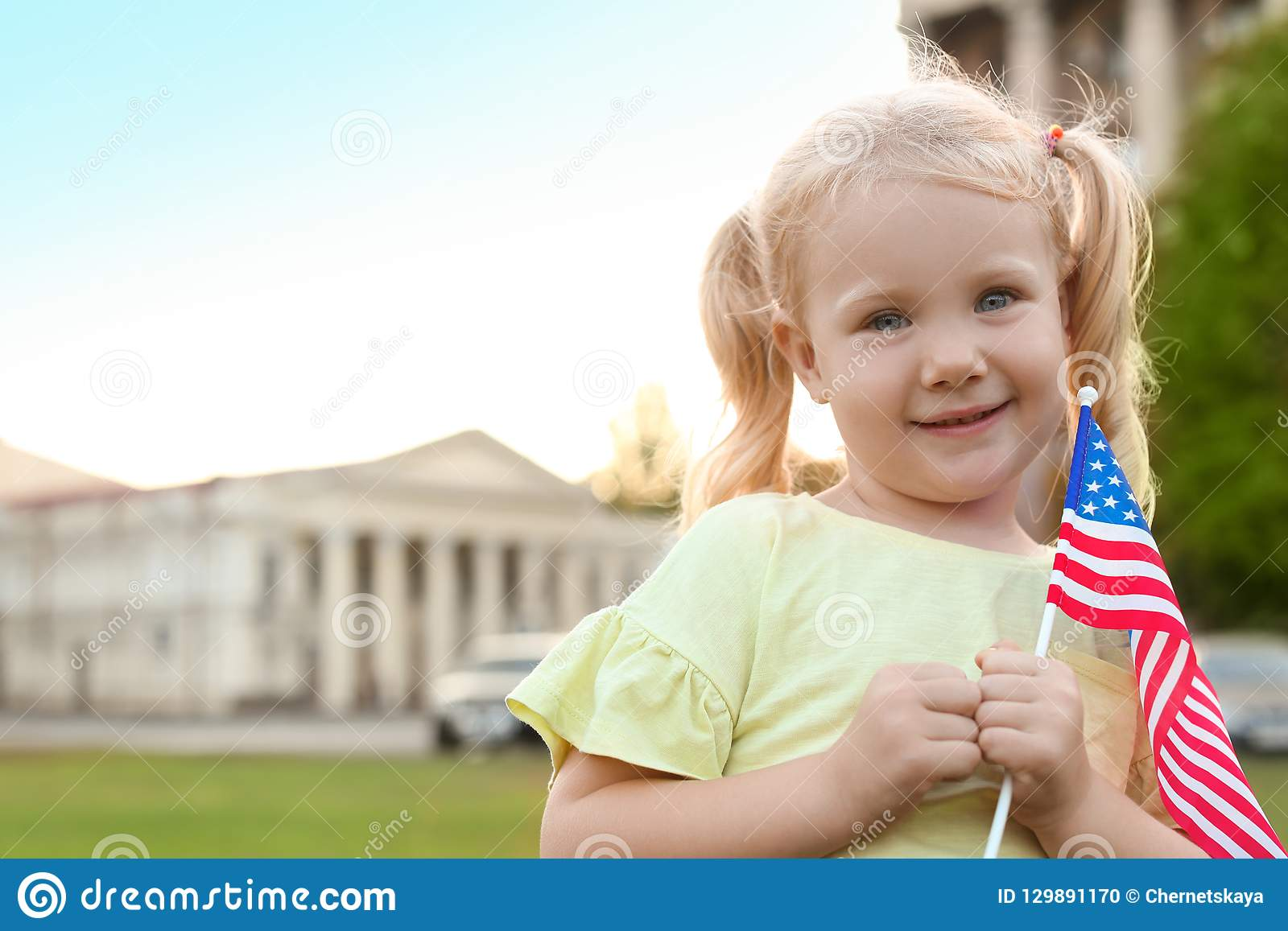 Cute little girl with American flag
