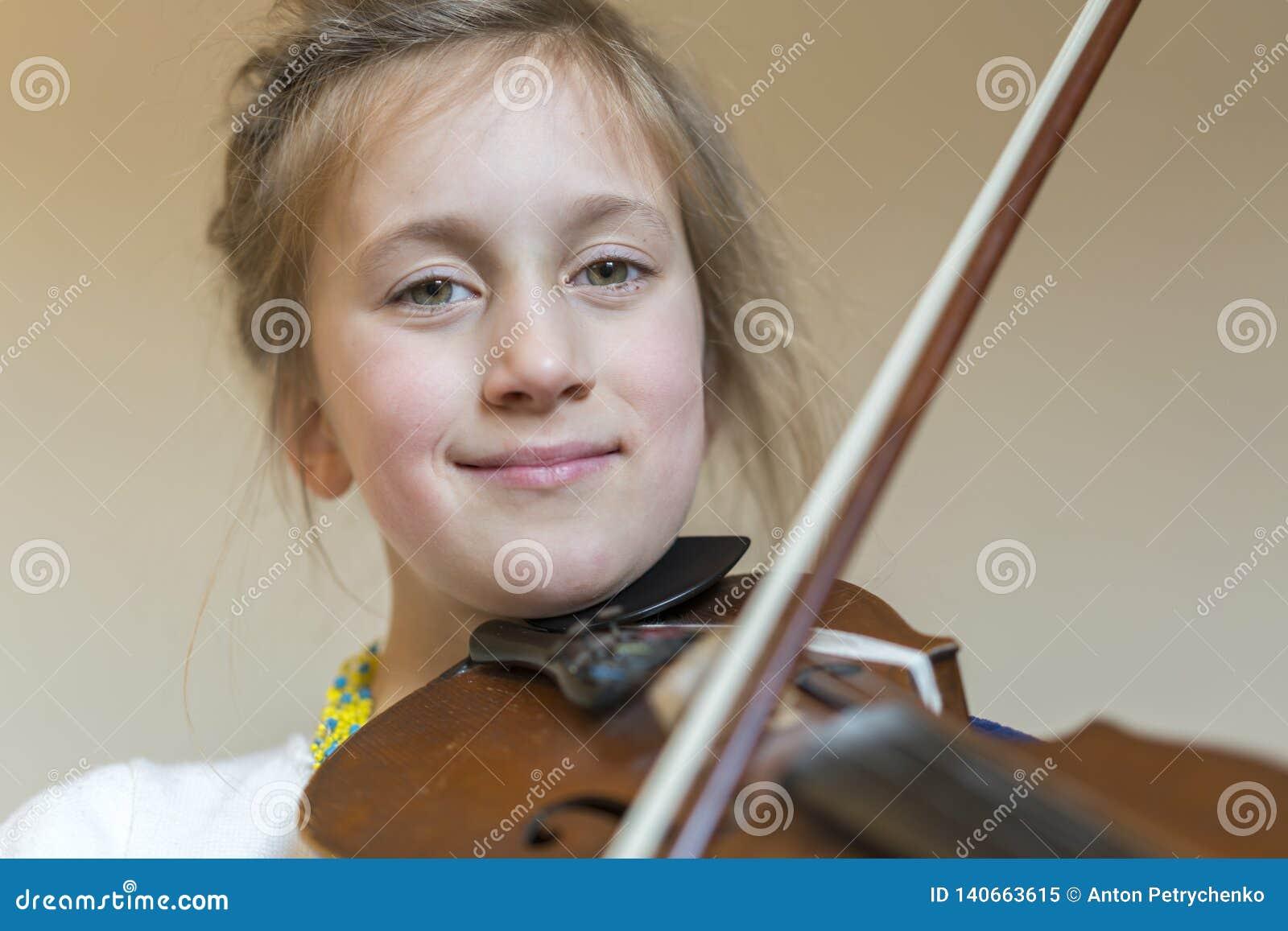 Cute Little Girl In A Beautiful Dress Playing Violin  Joyful