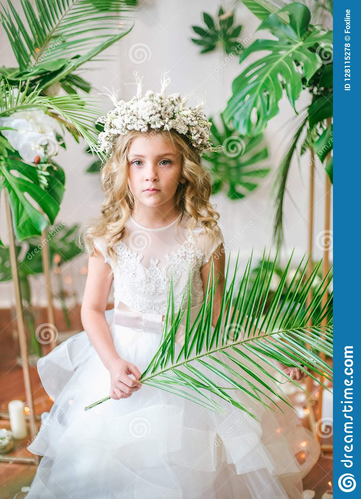 Cute Little Girl With Blond Curly Hair In A White Wedding