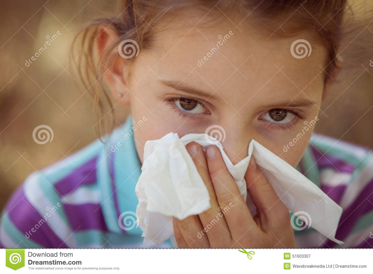 cute little girl blowing her nose in park stock image image of