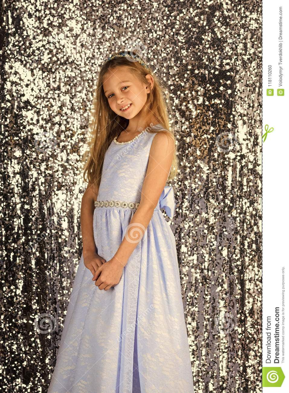 Cute Little Girl In Blue Dress Smiling On Camera With Long Hair