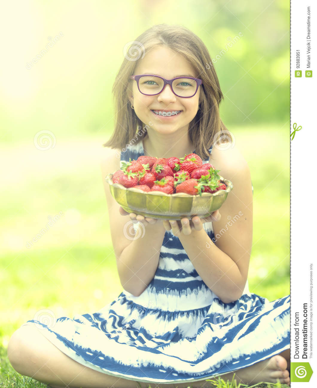 Cute Little Girl With Bowl Full Of Fresh Strawberries Pre