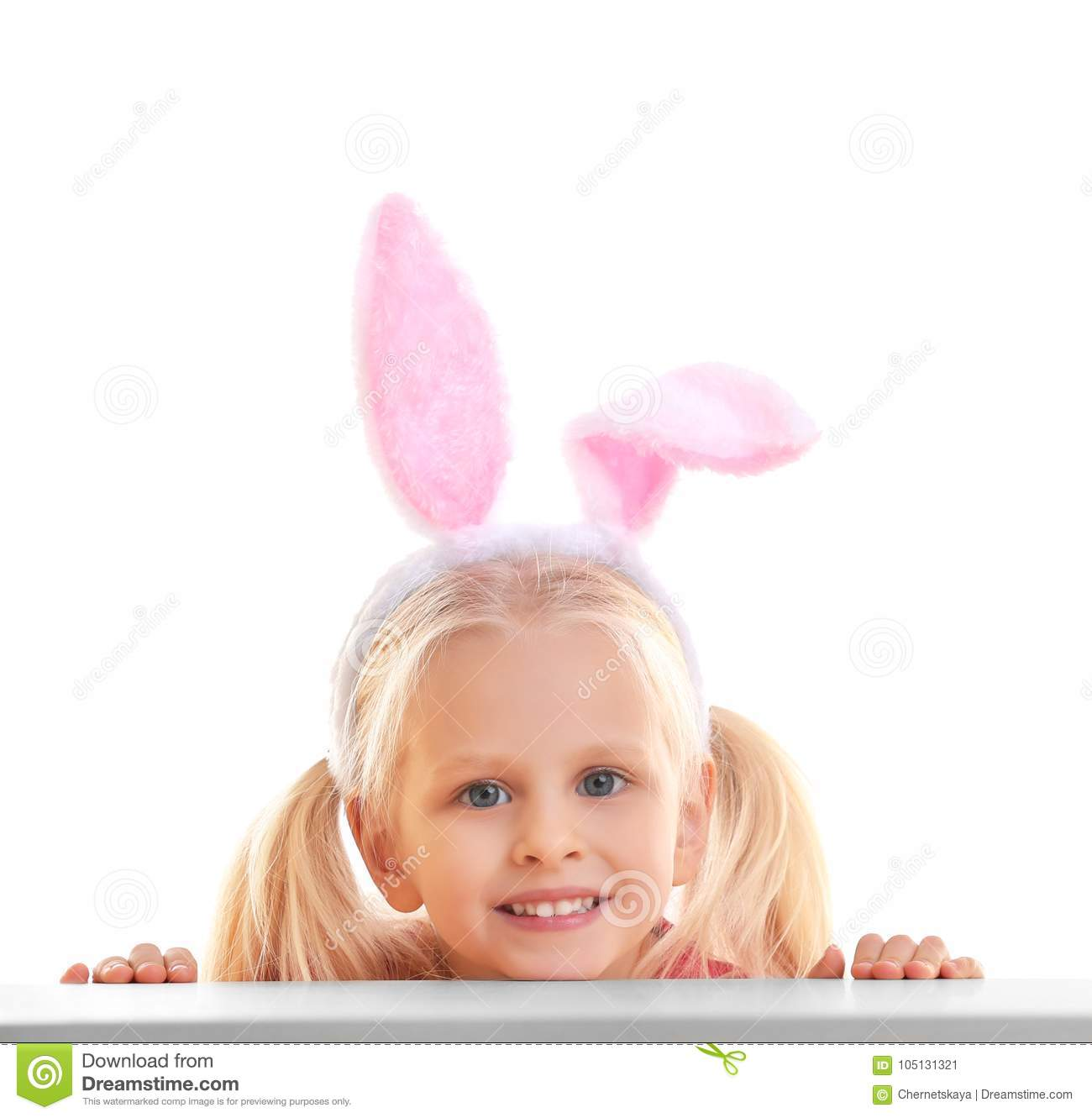 Cute little girl with bunny ears and basket full of Easter eggs on background