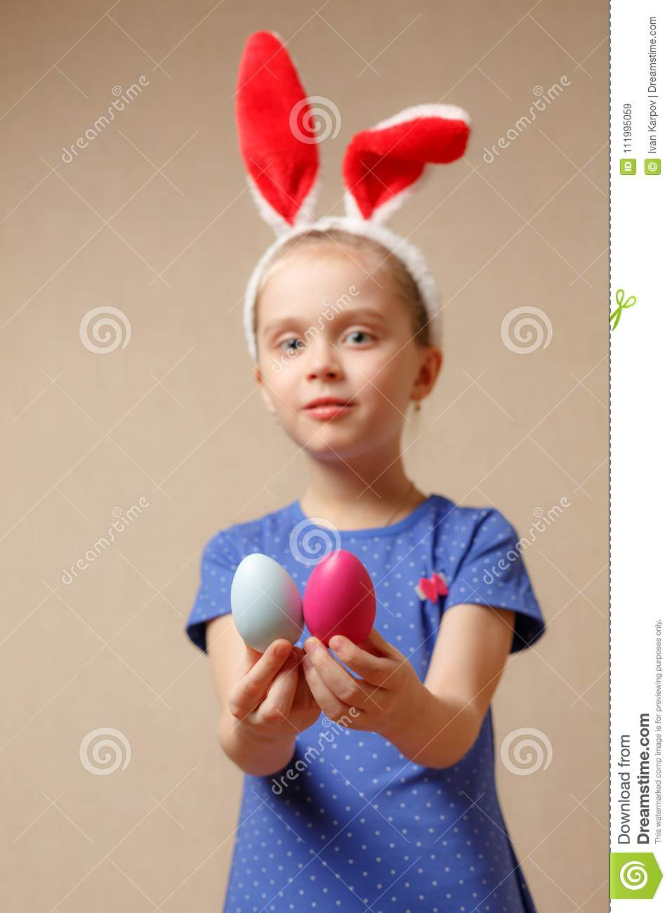 Cute little girl with bunny ears and Easter eggs. selective focus