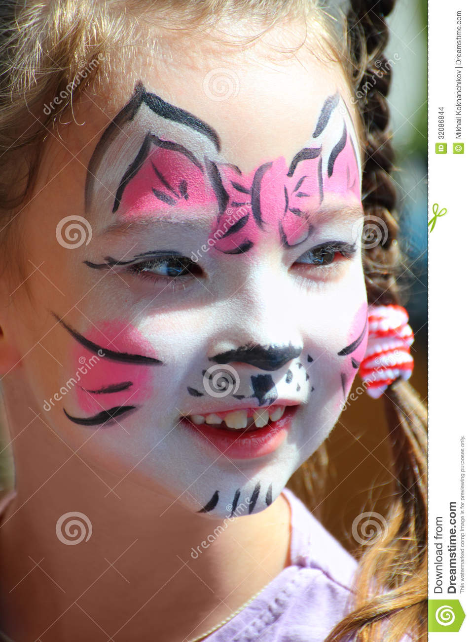 Cute little girl with cat makeup