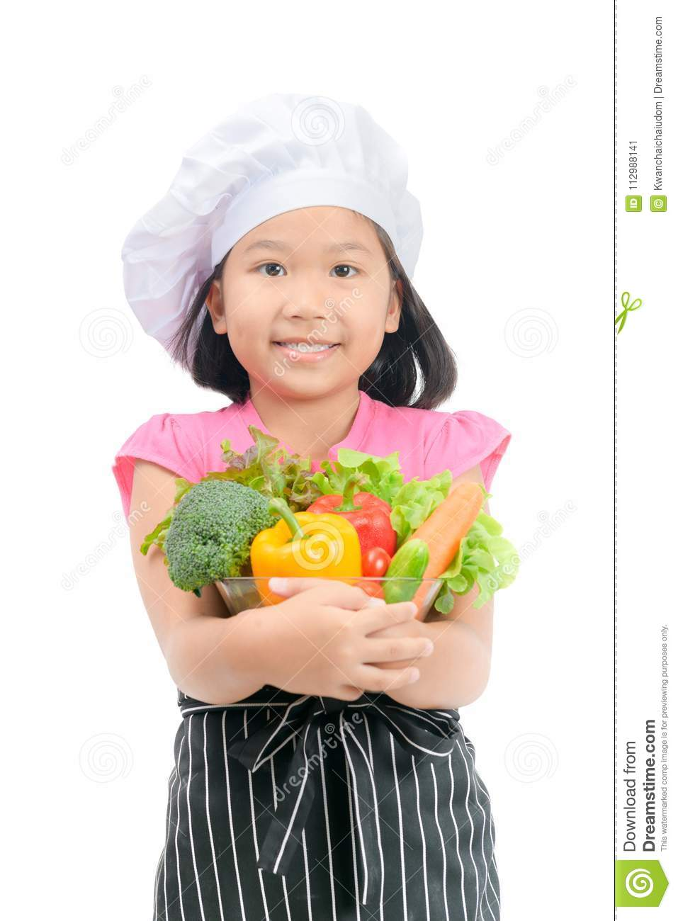 Cute little girl chef with vegetables