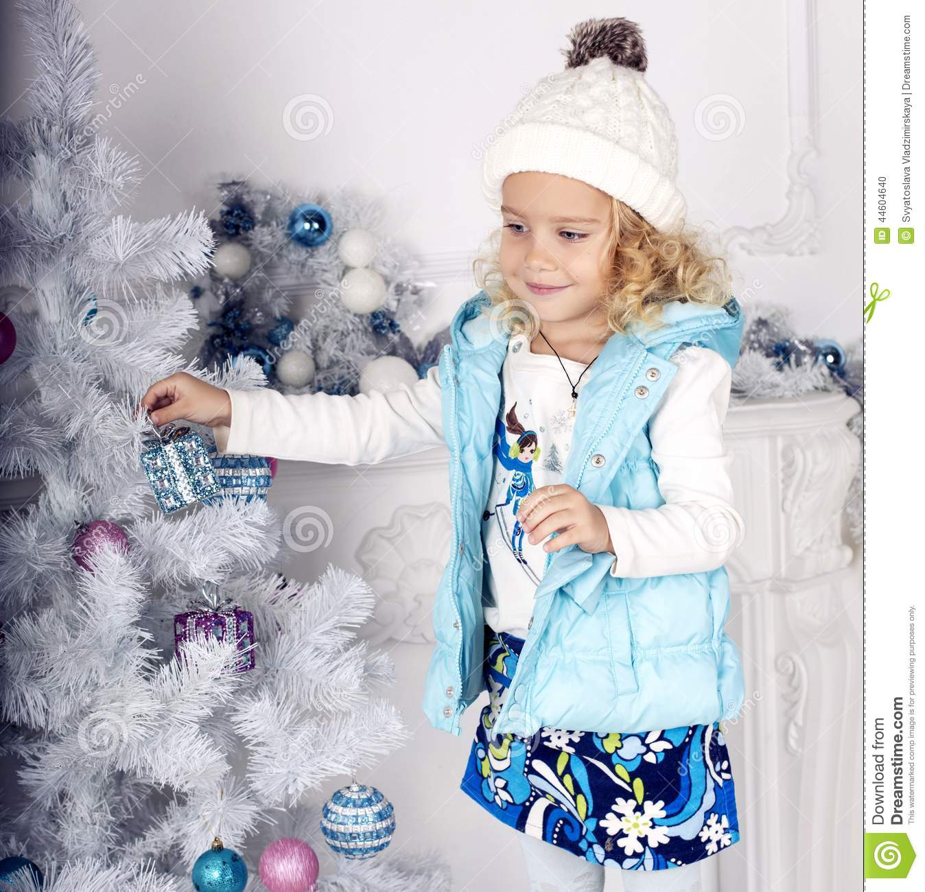Little Girl Christmas Tree: Cute Little Girl Decorating Christmas Tree Stock Photo