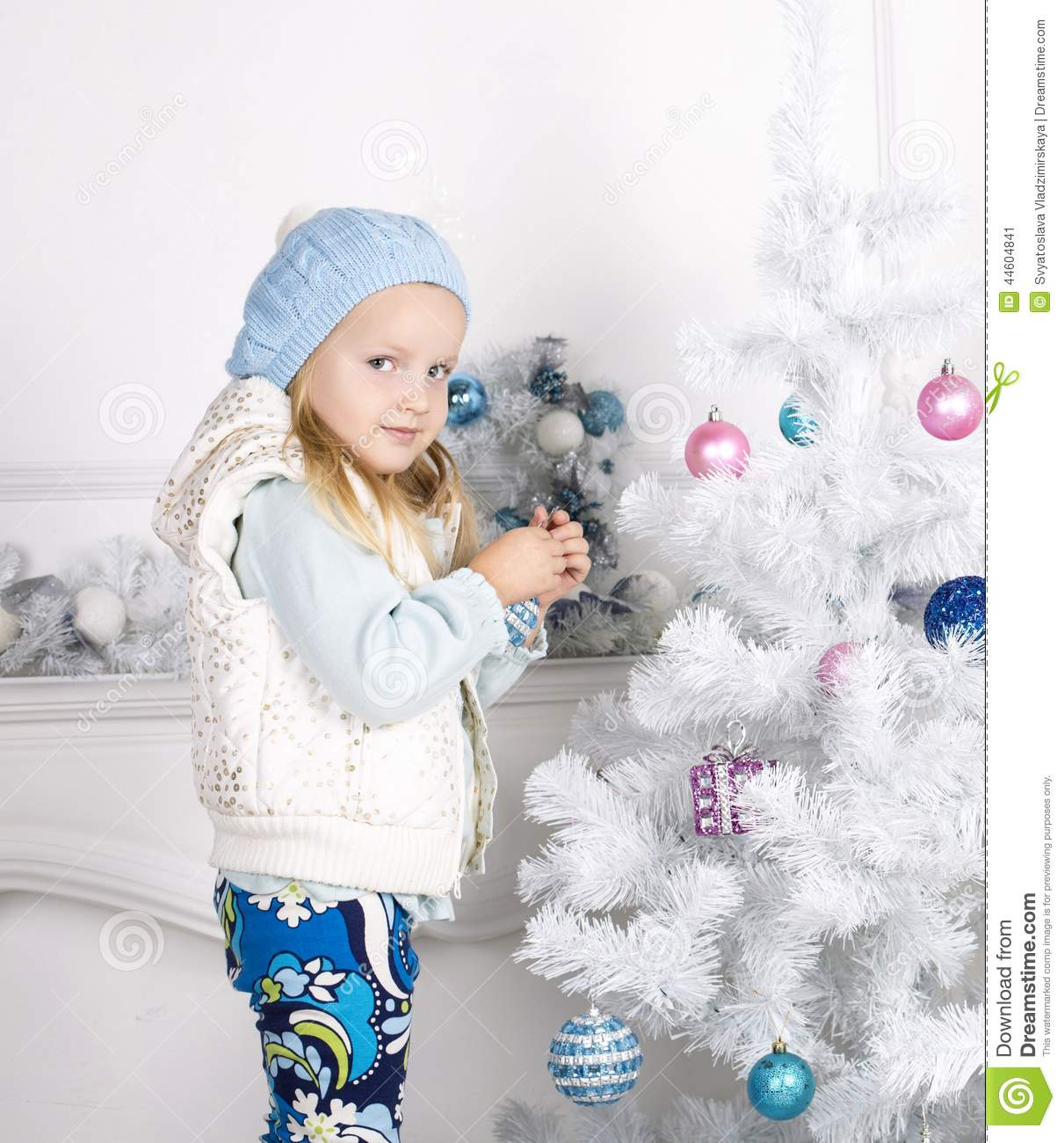 Little Girl Christmas Tree: Cute Little Girl Decorating Christmas Tree Stock Image