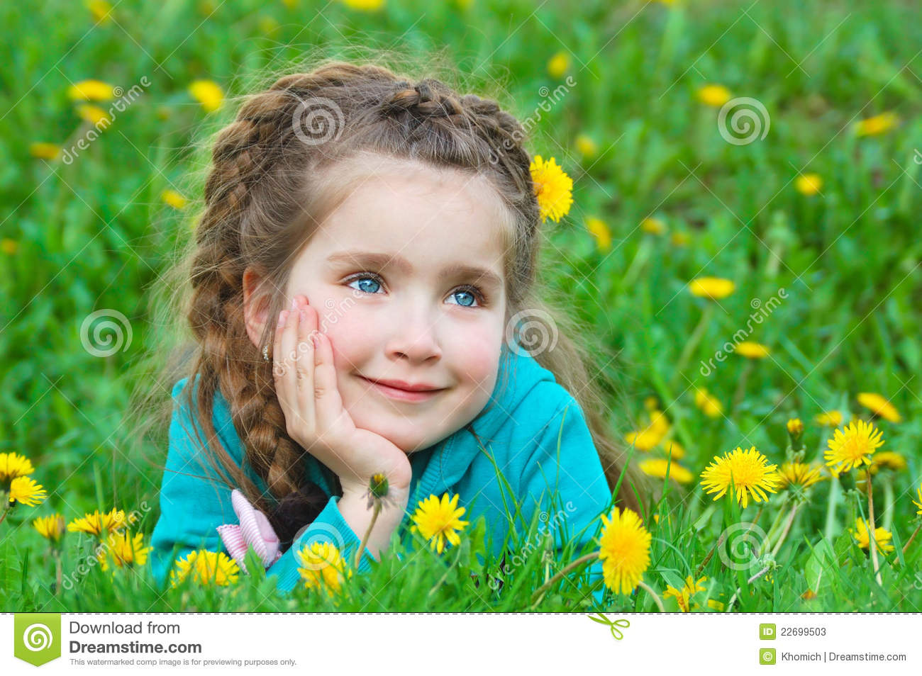cute little girl dreaming on green grass stock image - image of
