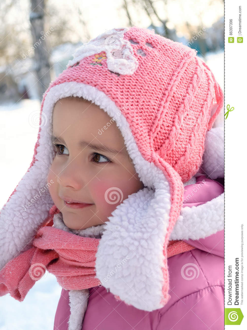58033b3f4 Cute Little Girl Enjoying Winter And Snow Dressed In Warm Pink C ...