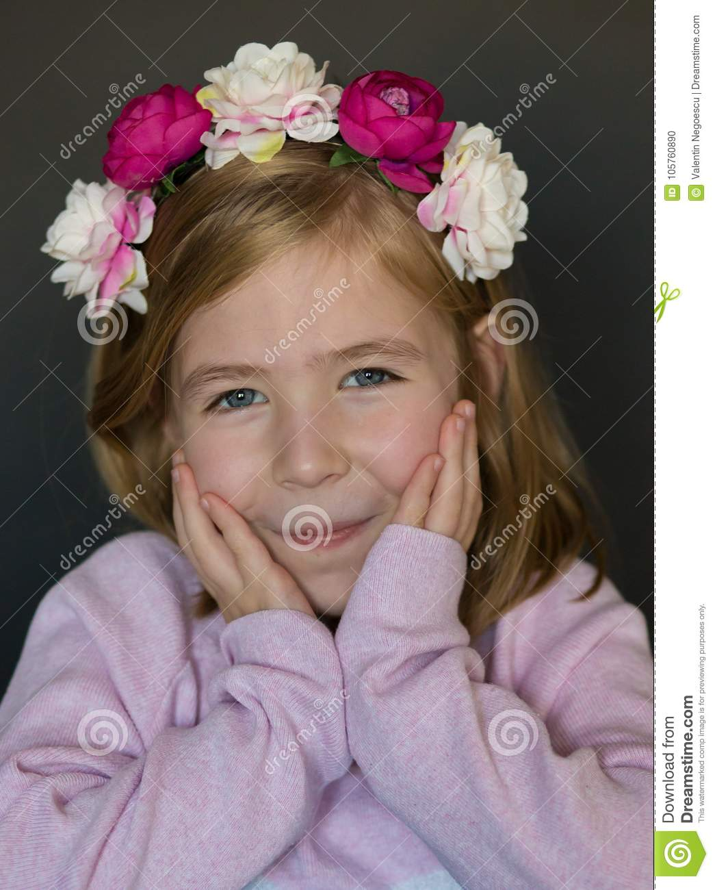 A cute little girl with flowers crown on her head stock photo a cute little girl with flowers crown on her head izmirmasajfo