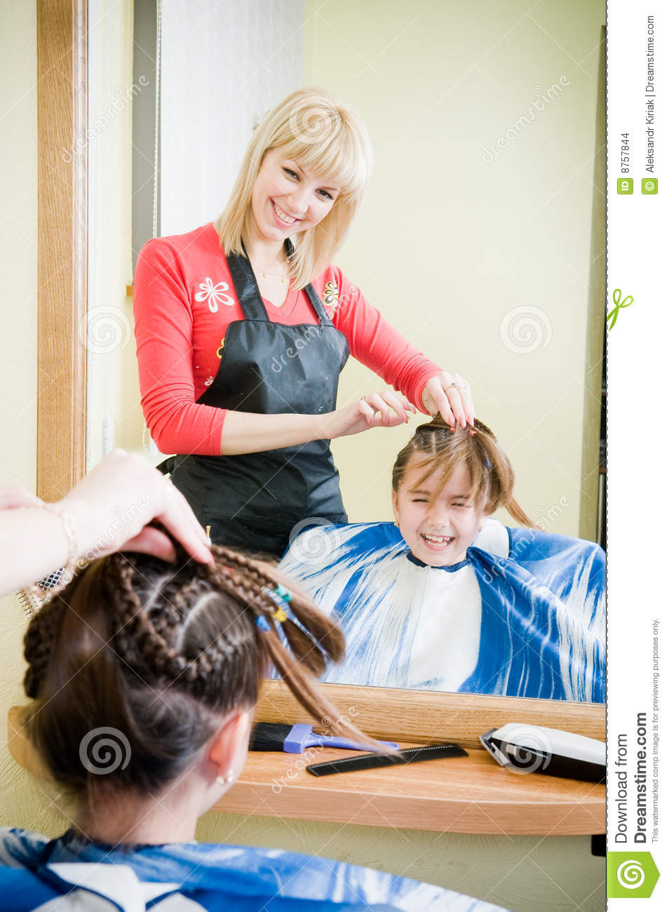Cute Little Girl Getting Her New Haircut Stock Photo