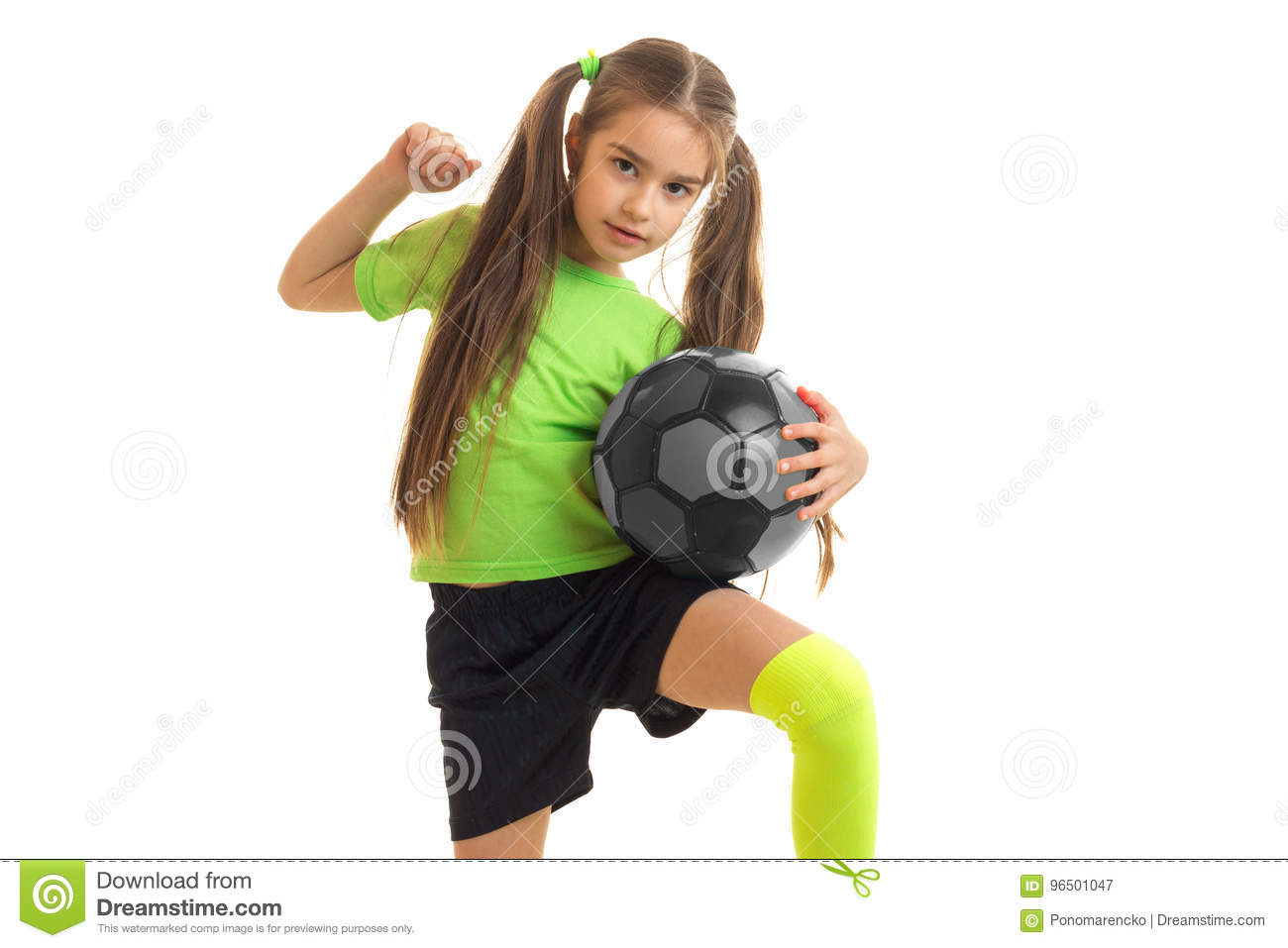 938df3cb0 Cute Little Girl In Green Uniform Playing With Soccer Ball Stock ...