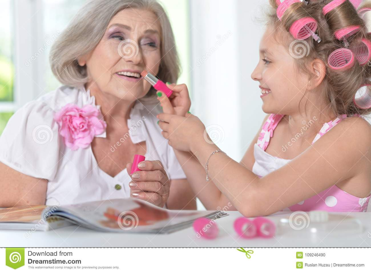 Little Girl With Granny With Magazine And Nail Polish Stock Photo ...
