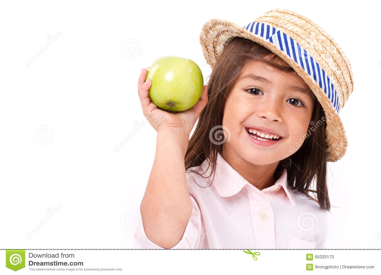 Cute little girl, hand holding green apple